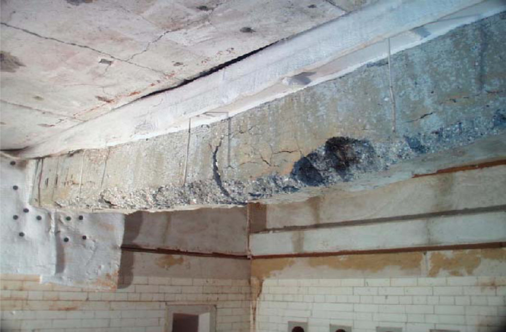 Failure of beam 2 after fire test inside the furnace shows some flexural cracks and rupture in the main reinforcement.